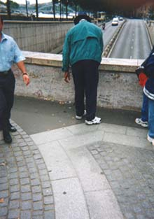 The Participant taps the ground with his cane